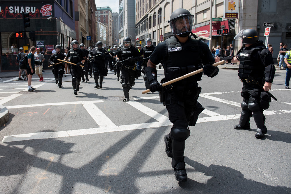 Boston, MA - 8/19/17 - State police in riot gear respond on the outskirts of the Boston Common where free speech and other conservative groups sparked an enormous counter-protest on Saturday, August 19, 2017. This day's protest occurred as part of the ongoing national outrage after protests in Charlottesville, Virginia turned deadly last weekend, primarily in opposition to what's seen as a rise in prominence and visibility of white supremacists and Neo-Nazis. (Nicholas Pfosi for The Boston Globe) Topic: 20rally photos (only)