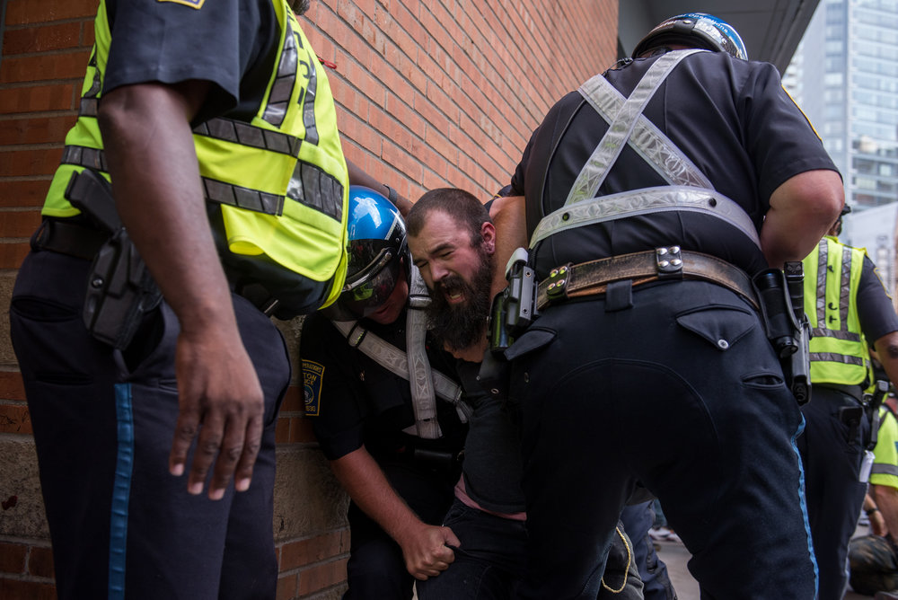 Boston, MA - 8/19/17 - A protester is arrested on Washington St. following a relatively peaceful march and protest on the Boston Common on Saturday, August 19, 2017. This day's protest occurred as part of the ongoing national outrage after protests in Charlottesville, Virginia turned deadly last weekend, primarily in opposition to what's seen as a rise in prominence and visibility of white supremacists and Neo-Nazis. (Nicholas Pfosi for The Boston Globe) Topic: 20rally photos (only)