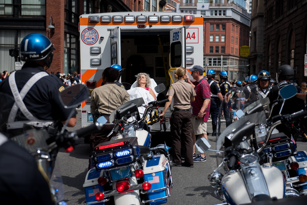 Boston, MA - 8/19/17 - A woman who declined to be identified is treated by medics and taken away in an ambulance after she was caught up in an aggressive brawl between protesters and state police in riot gear on the outskirts of the Boston Common where free speech and other conservative groups sparked an enormous counter-protest on Saturday, August 19, 2017. This day's protest occurred as part of the ongoing national outrage after protests in Charlottesville, Virginia turned deadly last weekend, primarily in opposition to what's seen as a rise in prominence and visibility of white supremacists and Neo-Nazis. (Nicholas Pfosi for The Boston Globe) Topic: 20rally photos (only)