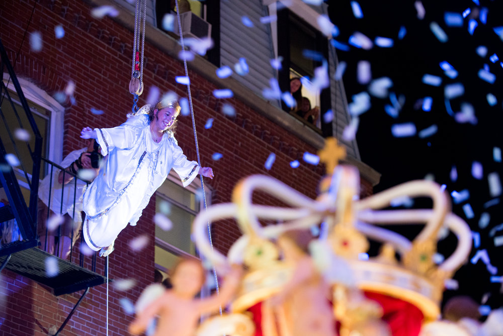 Boston, MA - 8/20/17 - Ava Trovata, as the Flying Angel, during the Flight of the Angel, which is part of the Fisherman's Feast of the Madonna Del Soccorso di Sciacca in Boston's North End on Sunday, August 20, 2017. (Nicholas Pfosi for The Boston Globe) This years Flying Angel is Ava Trovato Bonavita, with side angels Victoria Carregal and Sophia Fialkosky.Topic: 21angel