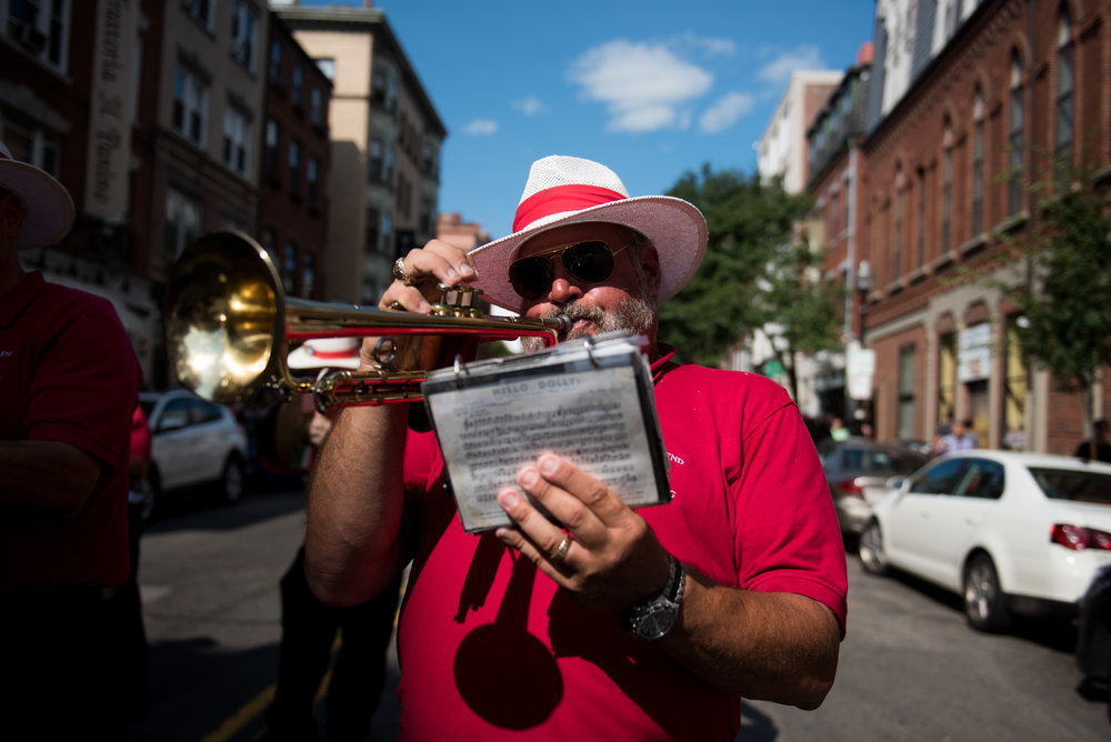 Boston, MA - 8/20/17 - The North End Marching Band performs as part of a precession on Flint St during the Fisherman's Feast of the Madonna Del Soccorso di Sciacca in Boston's North End on Sunday, August 20, 2017. (Nicholas Pfosi for The Boston Globe) Topic: 21angel