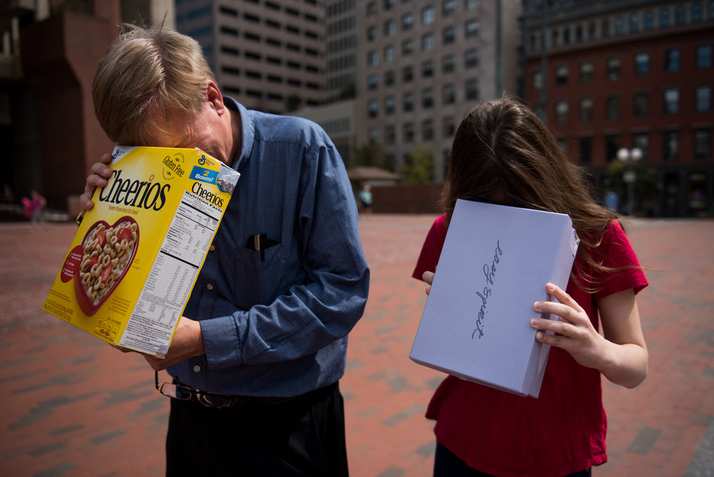 Boston, MA - 8/21/17 - Mike Wilson, left, and his daughter Stephanie, check out the partial solar eclipse in City Hall Plaza on Monday, August 21, 2017. (Nicholas Pfosi for The Boston Globe) Topic: 22eclipsepic