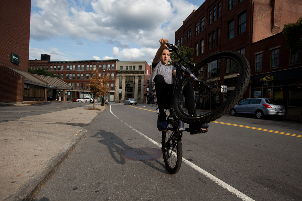 Lowell, MA - 8/25/17 - Ethan Olmeda shows off his bike skills in downtown Lowell on Friday, August 25, 2017. (Nicholas Pfosi for The Boston Globe) Reporter: Catie Edmondson Topic: 24lowellfuture(2)