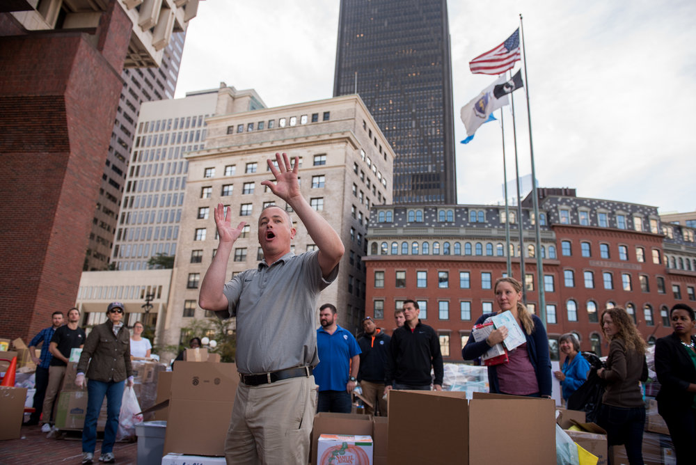 Boston, MA - 9/1/17 - Patrick Brophy, the Mayor's Chief of Operations instructs volunteers during a rush to sort and package donated supplies to Hurricane Harvey victims in Houston, Texas on the Boston City Hall Plaza on Friday, September 1, 2017. (Nicholas Pfosi for The Boston Globe) Reporter: John Ellement Topic: 02cityhall