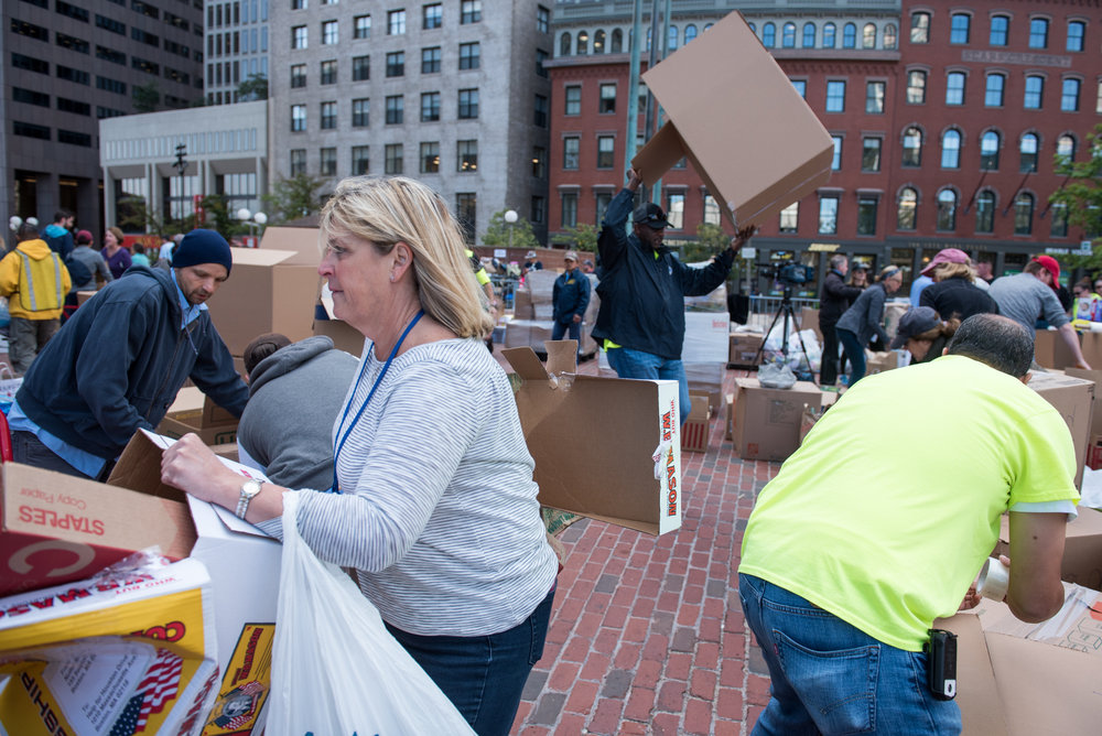 Boston, MA - 9/1/17 - Volunteers from all over Boston rush to sort and package donated supplies to Hurricane Harvey victims in Houston, Texas on the Boston City Hall Plaza on Friday, September 1, 2017. (Nicholas Pfosi for The Boston Globe) Reporter: John Ellement Topic: 02cityhall