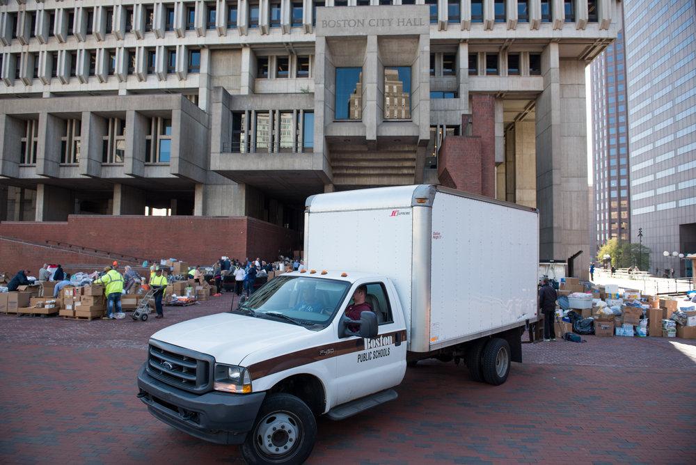 Boston, MA - 9/1/17 - A Boston Public Schools truck is used move donated supplies to Hurricane Harvey victims in Houston, Texas on the Boston City Hall Plaza on Friday, September 1, 2017. (Nicholas Pfosi for The Boston Globe) Reporter: John Ellement Topic: 02cityhall