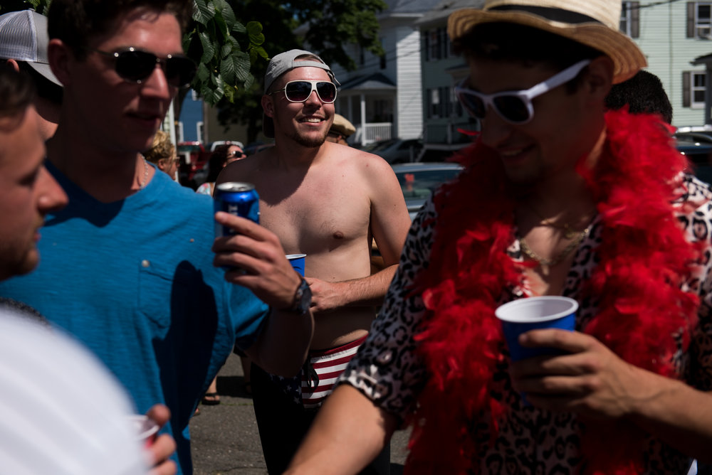 Gloucester, MA - 6/25/17 - Randy Sweet, the winner of Friday's and Saturday's greasy pole competition, arrives at a house party during the St. Peter's Fiesta in Gloucester, Mass. on Sunday, June 25, 2017. Each year a select group of men, some novices, others seasoned champions, compete against each other to see who can run across a telephone pole layered in grease and suspended over the sea. This year after one full round, Gloucester resident, Jake Wagner, grabbed the flag, claiming victory. (Nicholas Pfosi for The Boston Globe) 