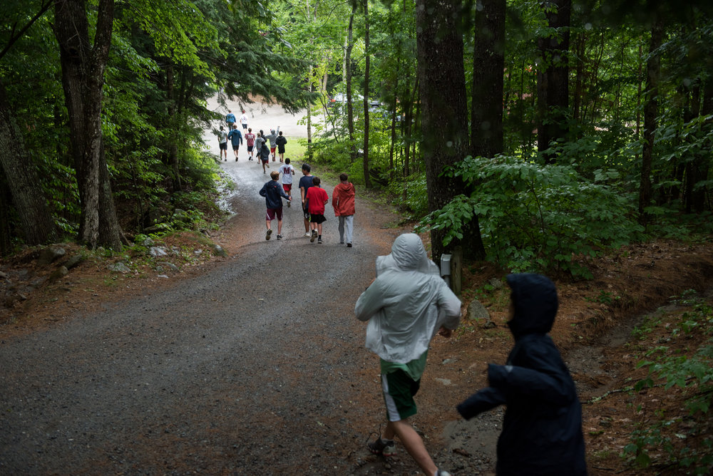 Orford, NH - 7/17/17 - Campers head down to dinner during a rainy afternoon at Camp Moosilauke on Monday, July 17, 2017. Because of the weather, the power was temporarily knocked out but campers continued on with flash lights, hardly missing a beat. (Nicholas Pfosi for The Boston Globe) 