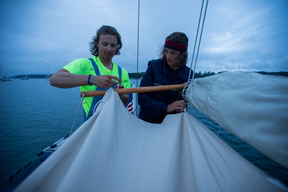 Brooklin, ME - 8/4/17 - Simon and Ethan set up a bimini on Sinbad in Brooklin on Friday, August 4, 2017. The Conover clan has come together for years to race in the Eggemoggin Reach Regatta. (Nicholas Pfosi for The Boston Globe) Reporter: Bethany Ao Topic: woodenboatEmma Conover, 23; tall, skinny, often wear hatsEthan Andrus, 15; Jen's son, long hair, often has headband, biked downJen Conover; mother, biked downLydia Morin, 20; niece of Jen, biked down, has straw hat on SinbadDee Dee Conover, 82; 82 years oldElli Andrus, 12; Ethan's sister; youngest, blonde hairSimon Morin, 18; Lydia's brother, longer hair, tallCedar Andrus; not a lot of photos of him, blonde hair, shorterWill Conover, 21; tallest, Peace Corps guy, curly hair
