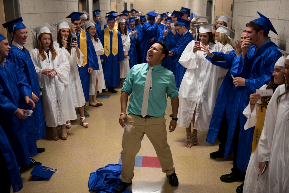 6/5/16 – Wilmington, MA – Daniel Goodwin sings and dances in the hallway before he and his classmates process into the gym right before Wilmington High School's Class of 2016 graduation ceremony in Wilmington, Mass. on Sunday, June, 5, 2016. (Photo by Nicholas Pfosi)