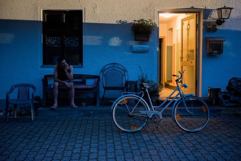 8/19/16 – Inzell, Bavaria – Hasan, who declined to give his last name, smokes a cigarette outside the Fantenberg Gasthof in Inzell, Germany on Friday, Aug. 19, 2016. (Photo by Nicholas Pfosi)