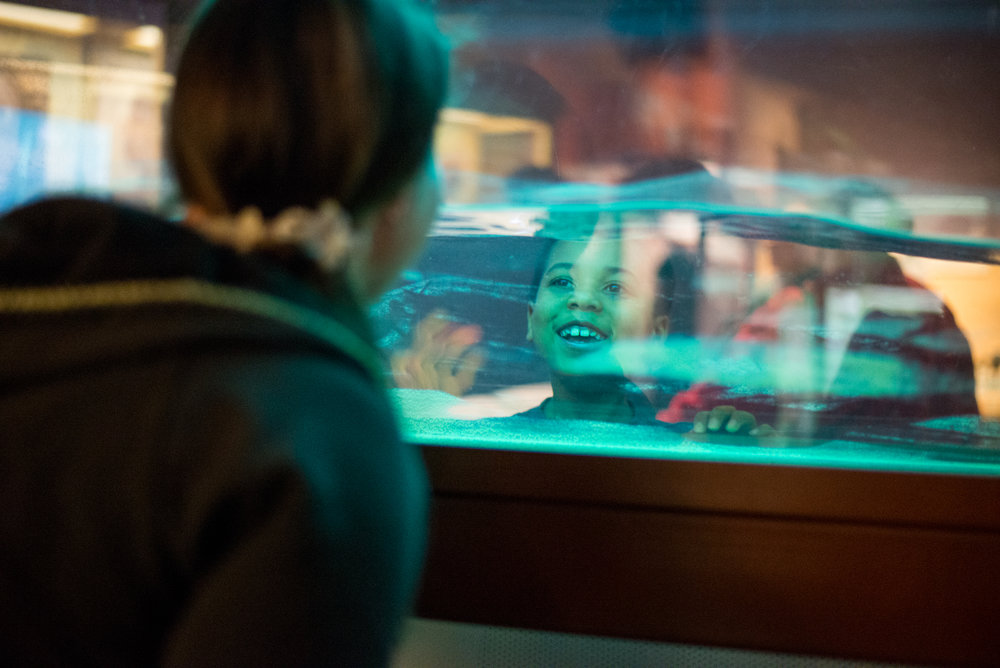 12/20/14 – Boston, MA – Tijan smiles through a wave maker at his mother, Whitney during their trip to the Musuem of Science in Boston, Mass. for Masi's first birthday (which was on the 18th) on Saturday, December 20th, 2014. (C) Nicholas Pfosi Photography
