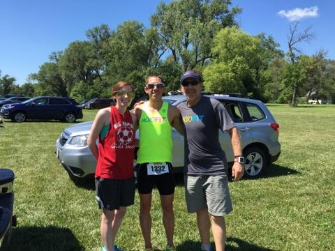 Cousin Britt, me, and dad post-race