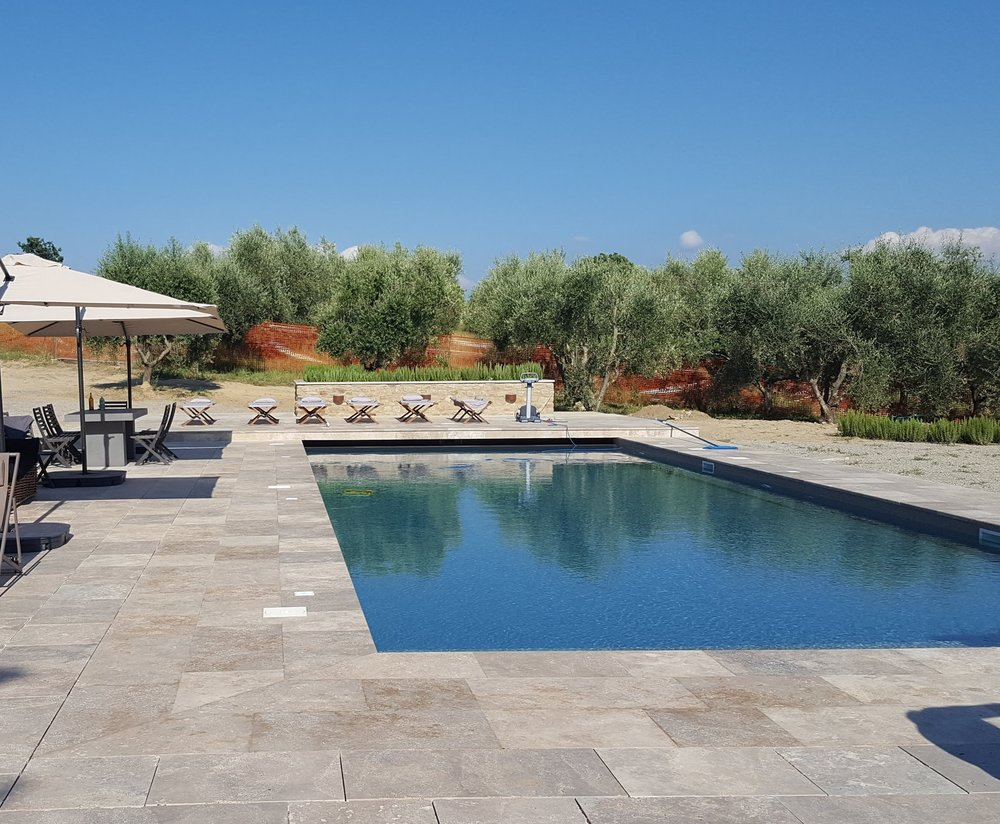 Our amazing pool and sun-deck, complete with loungers and umbrelloni!
