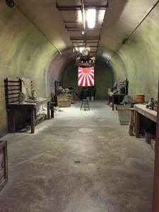 One Of The Sets From The TV Show Lost Long Dimly Lit Bunker With Minimal Furniture And A Japanese Flag Hanging At The End