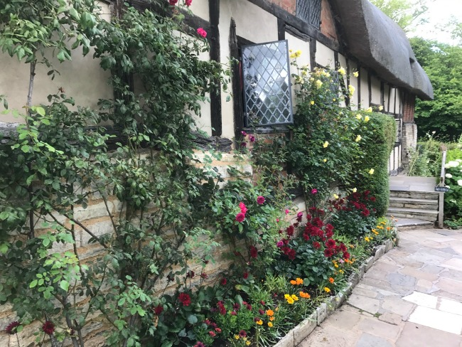Anne Hathways Cottage Stratford Upon Avon Shakespeare England Warwickshire Thatched Roof Rambling Roses Along Front Of Building