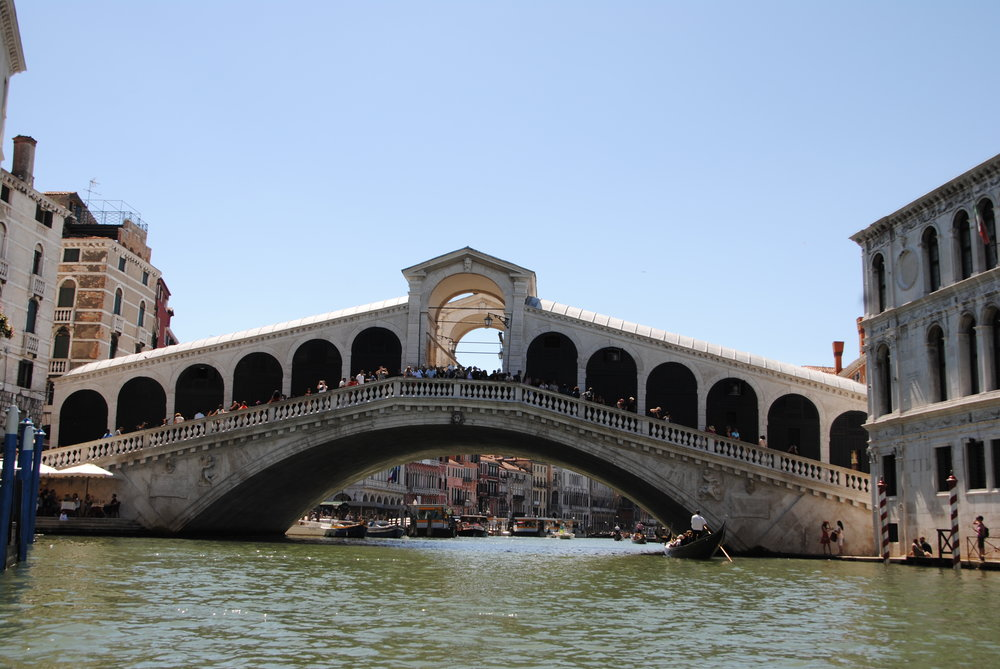 A view of the Rialto Bridge from a gondola on the Grand Canal