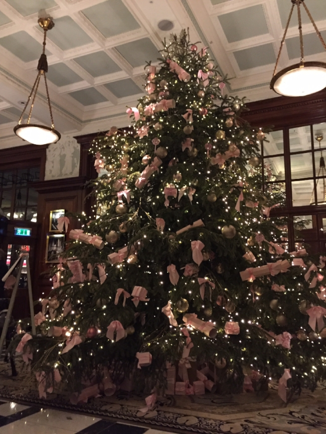 Christmas Tree At The Savoy In London Tiny White Lights Pink Bows and Pink Christmas Crackers