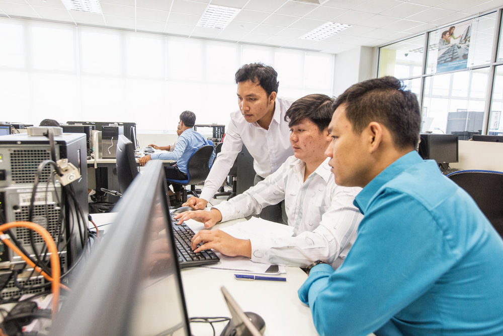 Kimleng Ly (centre), 27, and his team configuring an intra-network. Through TVET, he hopes to bring the latest skills and knowledge to Cambodia for his students at the Regional Polytechnic Institute Techo Sen Battambang.