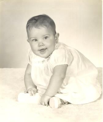 Well, since we have Scott's baby photo, we must have mine too!  See how I am sitting?  I was one of those odd kids who did not crawl, but scooted - I look ready to take off!