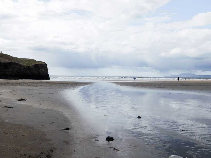 Surfers in Tullan Strand, Surf Spot in Bundoran, Ireland