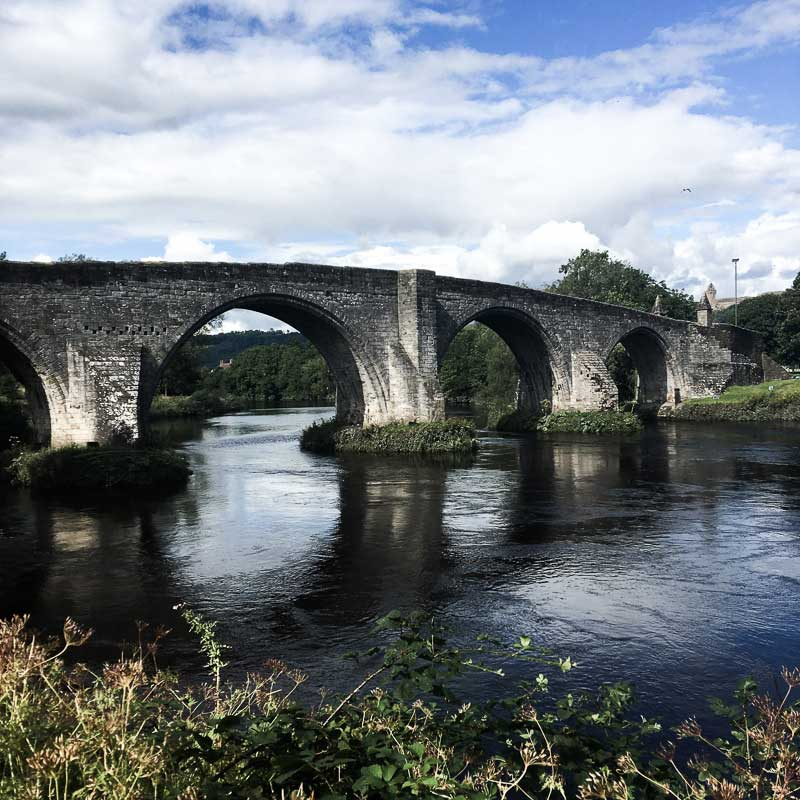 Stirling Old Bridge is located nearby the battlefield of the Battle of Stirling Bridge.