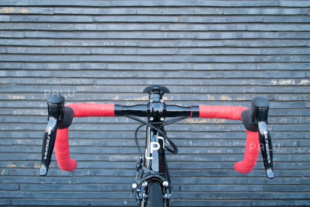 Palu-Pb002-Dedacciai-Carbon-Fibre-3k-Italian-Hand-Made-In-Italy-Custom-Hand-Tailored-Frame-Shimano-Ultegra-Di2-Groupset-Equinox-Wheelset-Carbon-Fibre-Rims-Spokes-Fizik-Arione-Braided-Saddle-London-black-02.jpg