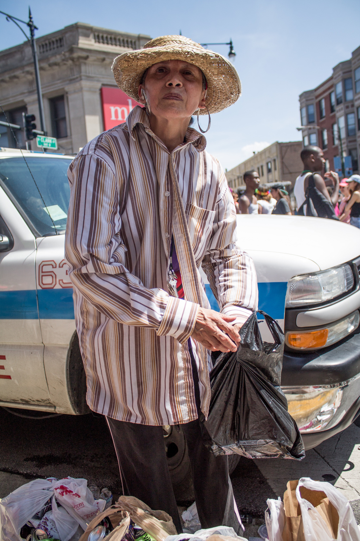 An Upset Woman Deposes Garbage, 2014