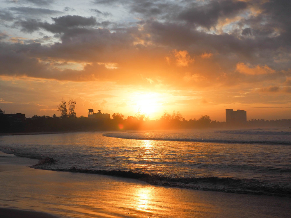 Sunrise on Weligama beach Sri Lanka by New Horizon Escapes