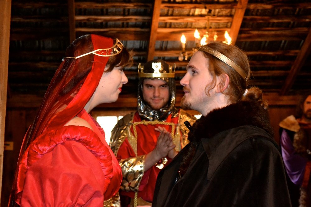 Zoey Selack as Lady Blanche along with the Prince Dauphin (Jamin Miller) as KING JOHN (RYAN SZWAJA) looks on.