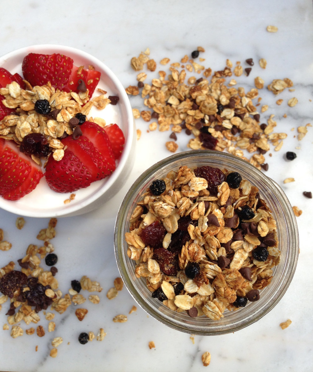 Homemade gluten free granola with blueberries,  cherries, and chocolate