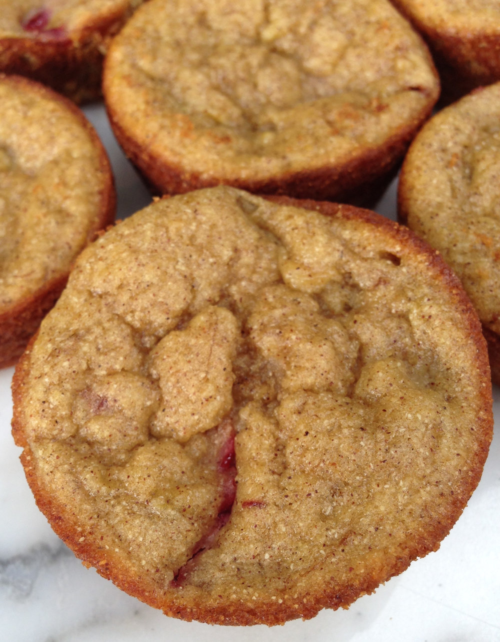 These gluten free, diary free muffins use garbanzo bean flour to add a nutty flavor that perfectly compliments the fruity flavor of the strawberries and bananas.