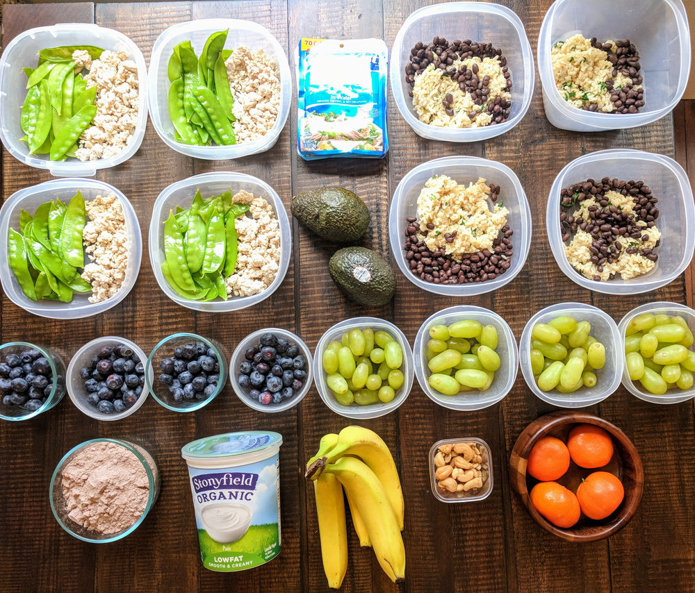 A colorful meal prep using leftovers from previous meals and convenience items in the kitchen.