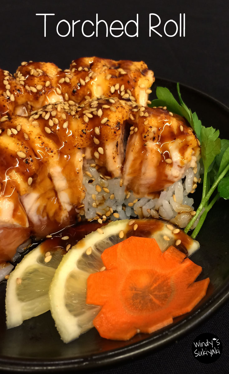 shrimp, scallop and caviar sauce in a sushi roll, then topped with fresh salmon and more caviar sauce. It's so fun to hear the popping sound and the aroma is just wonderful.