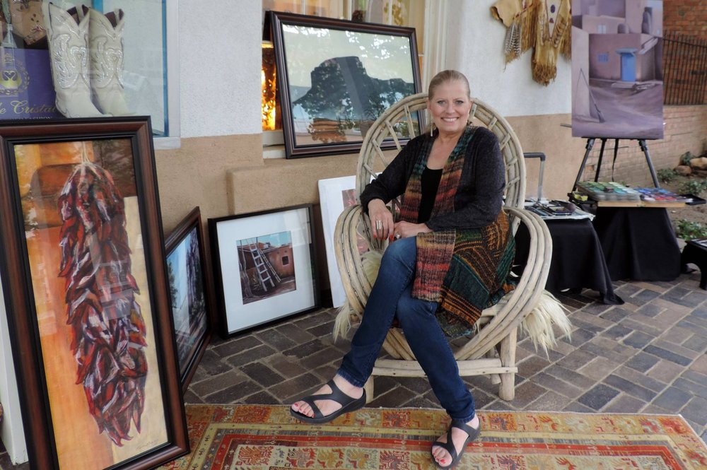 "Cheri Ginsburg taking a break from demonstrating ""pastel painting"", at the Santa Fe Gallery, Santa Fe, New Mexico."