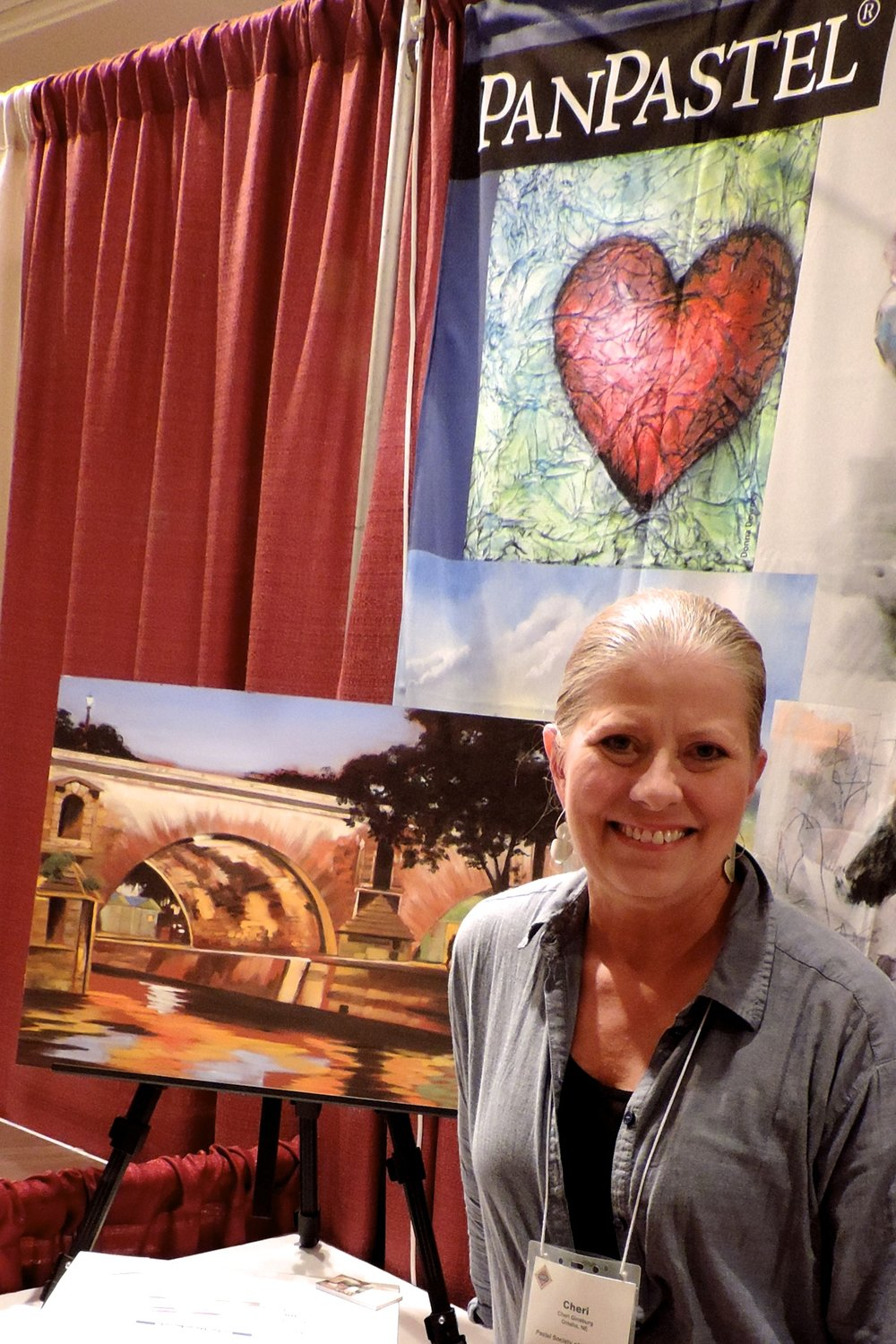 "Cheri Ginsburg honored to have ""PanPastel®"" display her painting ""Secret Rendezvous"", done entirely in PanPastel®,  in their vender booth at the International Association of Pastel Societies (IAPS) Biennial Convention- 2015."