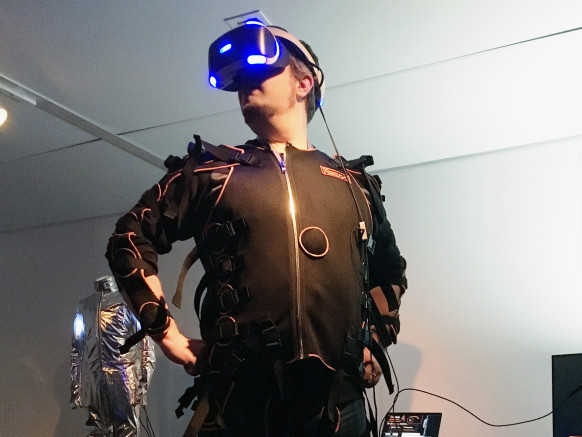 Wired author  Chris Kohler  donning the PlayStation VR and the custom full-body suit at PlayStation Experience. Photo by  Wired
