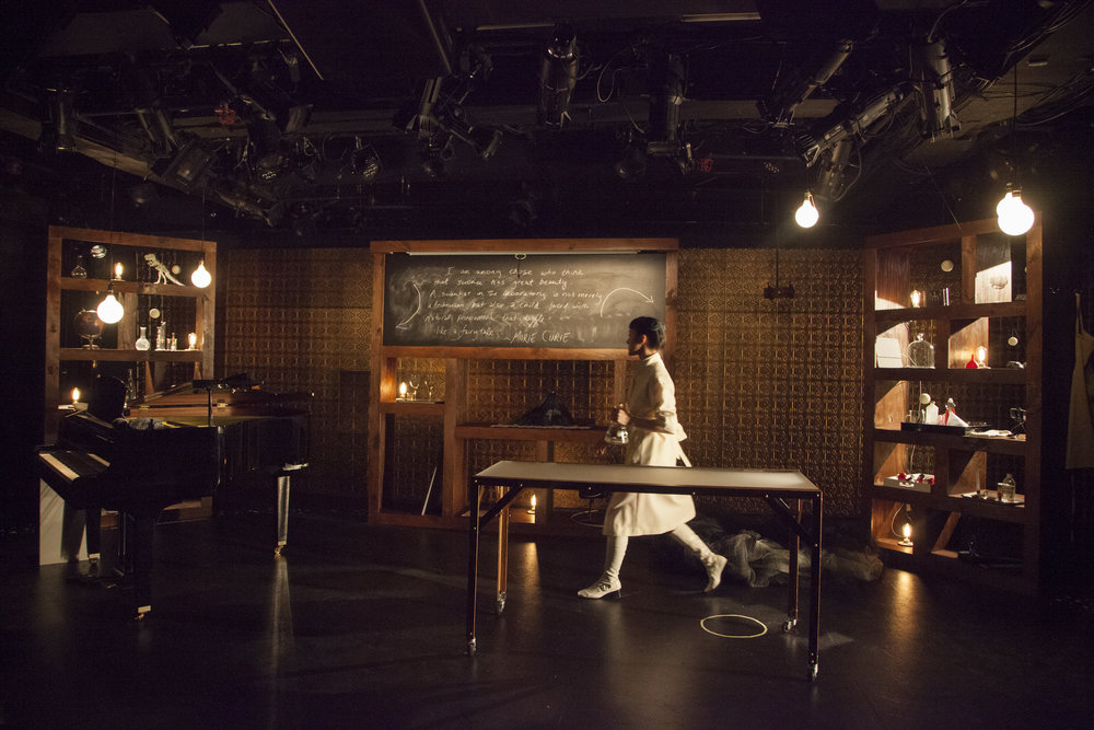 In the Science Fair Laboratory at HERE. Set Design by Cate Hevner Kemp, Lighting by Lucrecia Briceno, photo by Kate Milford