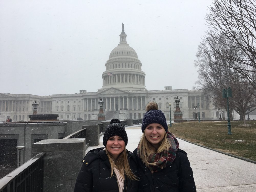 Meaghan (left) and Madeline (right) brave the elements to catch a glimpse of our nation's Capitol.