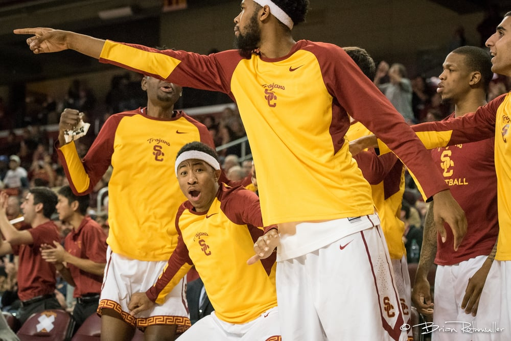 #2.     This is my favorite bench shot. USC's Elijah Stewart's face and expression is classic. As you can see, my process in shooting big plays is going right to the bench for a reaction after the play is complete. I also like to get the fan's reactions right after the play.