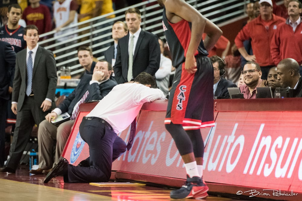 #4.   I was so focused on USC's reaction to a foul in the last OT that I didn't see Arizona Head Coach Sean Miller's epic reaction until a fan behind me was talking about it. I also love the guy at the media table smiling.