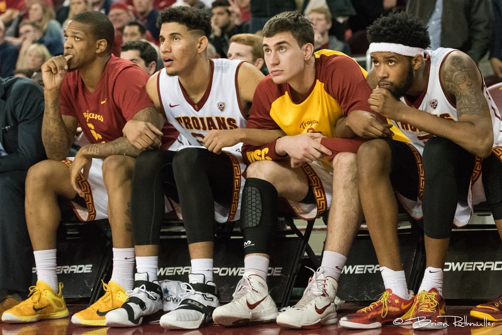 #3.     The USC bench trying to will in free throws that ultimately would give USC the victory in the 4th overtime. Great anticipation of the moment being captured with this shot.