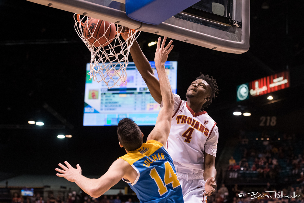 USC's Chimezie Metu dunks over UCLA's Gyorgy Golman   during the first half of the 2016 Pac-12 Tournament.  Photo by Brian Rothmuller