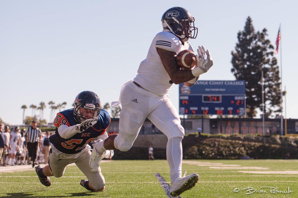 11/4/16 --- Football --- Fullerton College running back Phillip Butler (6) catches a touchdown pass as Orange Coast College's Bryce Garcia (59) tries to defend him during a game at LeBard Stadium in Costa Mesa, CA. Photo by Brian Rothmuller/Sports Shooter Academy