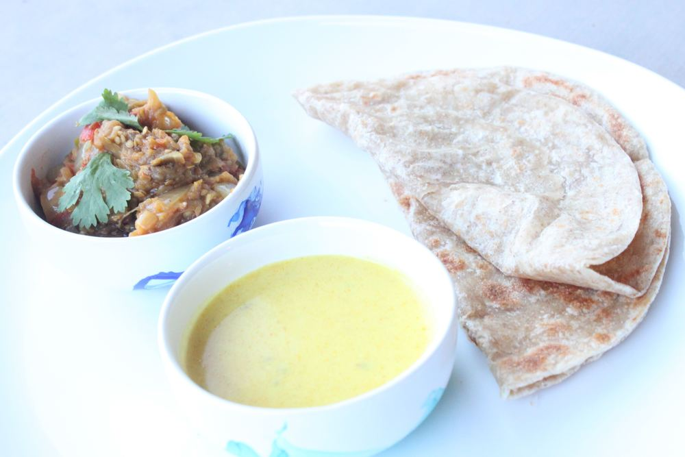 baigan bharta (far left) shown here with kudhi (curried yogurt soup) and rotli!