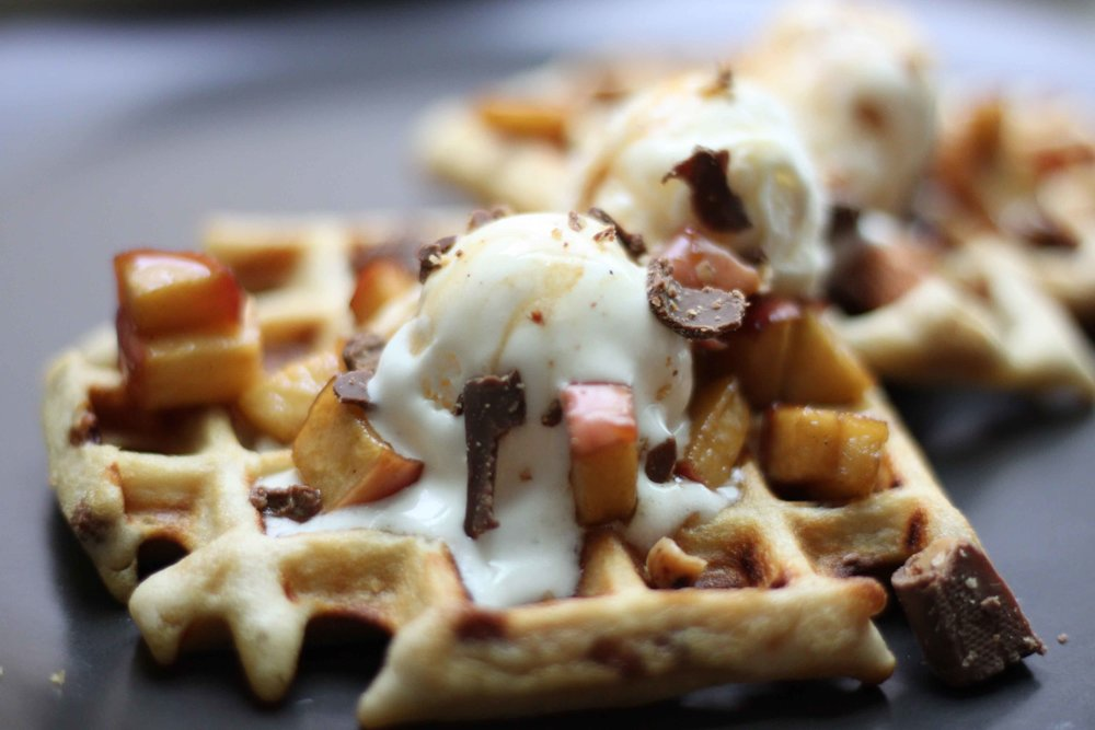 crunchy toffee & chai belgian waffles topped with vanilla bean ice cream, bourbon soaked caramelized apples.