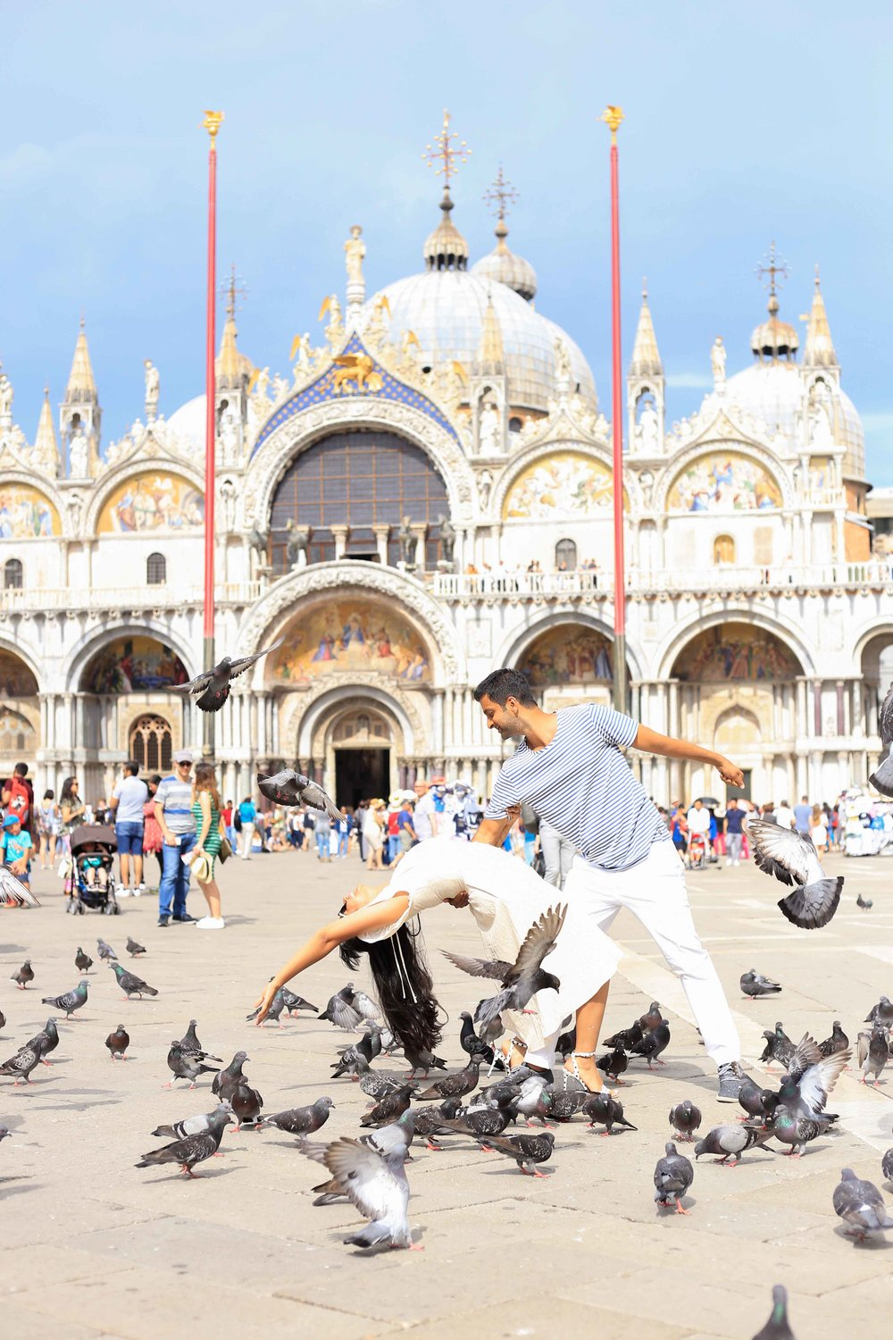 A quick dip with the pigeons outside St. Marks Basilica