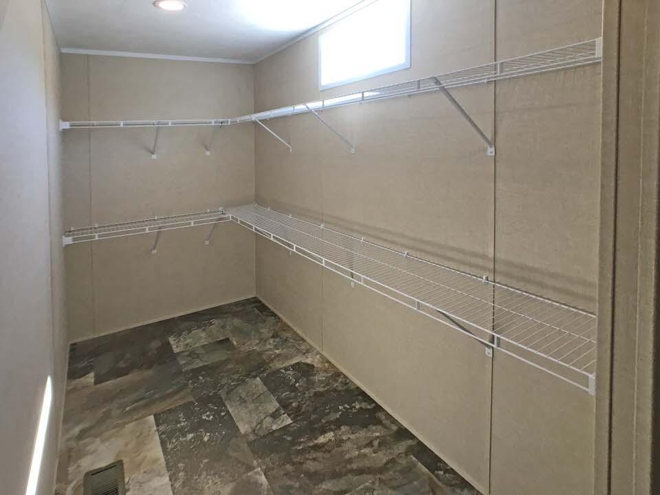 Walk-in closet in the master bedroom