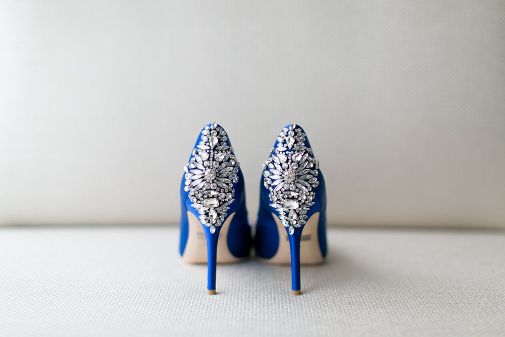 Bride's blue shoes at the Aria Hotel in Las Vegas, Nevada with elopement photographer Lovisa Photo.