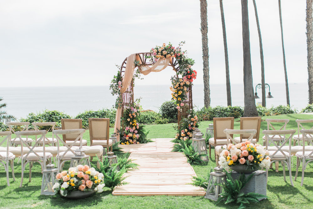 Ceremony decor at Ole Hanson Beach Club wedding in San Clemente, Ca with wedding photographer Lovisa Photo.